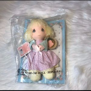 Precious moment doll of the month